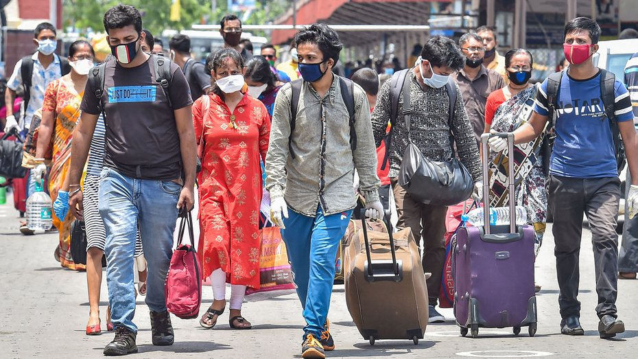 Passengers arrive at Howrah station to board a train, during the 4th phase of nationwide Covid-19 lockdown in Calcutta on Saturday.