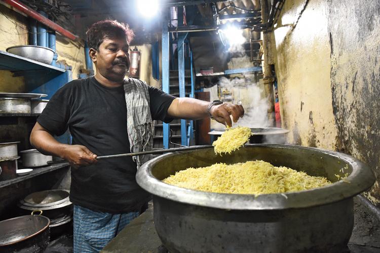 Md. Karim, head cook at Aliah, at work.