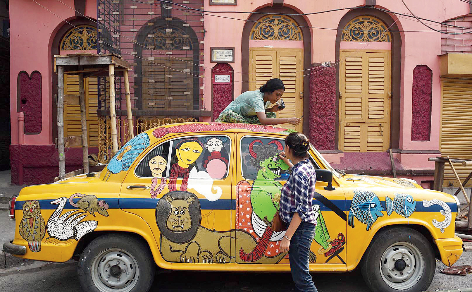 A taxi being painted as part of the two-day exhibition at Kumartuli on Thursday.