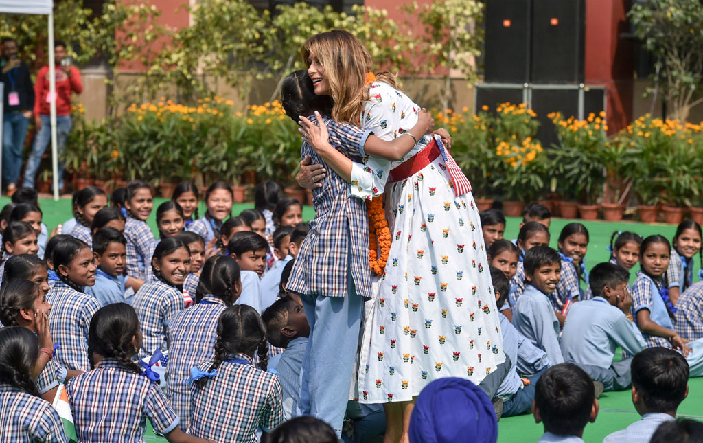 US First Lady Melania Trump hugs a school girl as she witnesses a happiness class, during her visit to a government school in New Delhi, Tuesday