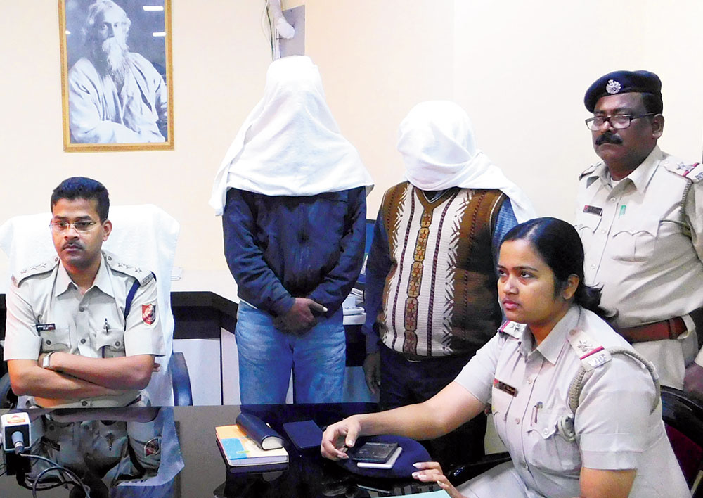 Bolpur subdivisional police officer Sowmojit Barua (left) with the arrested duo.