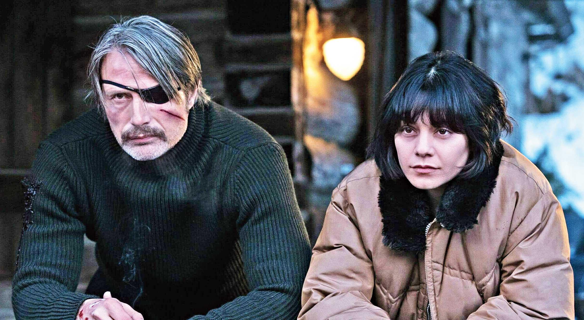 Mads Mikkelsen (left) and co-star Vanessa Hudgens in a scene from Polar