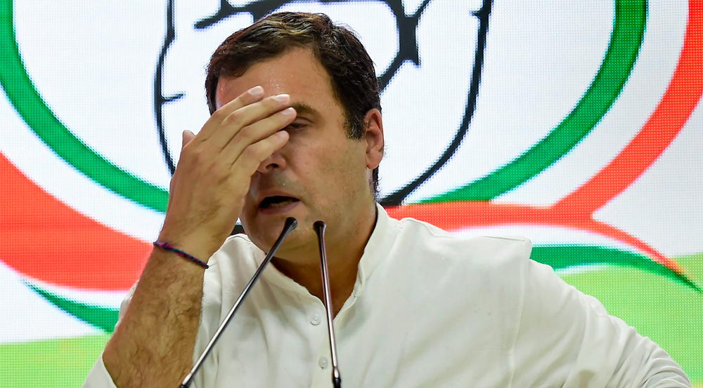 Congress President Rahul Gandhi reacts as he addresses a press conference on 2019 Lok Sabha polls results at the party headquarters in New Delhi, Thursday, May 23, 2019.