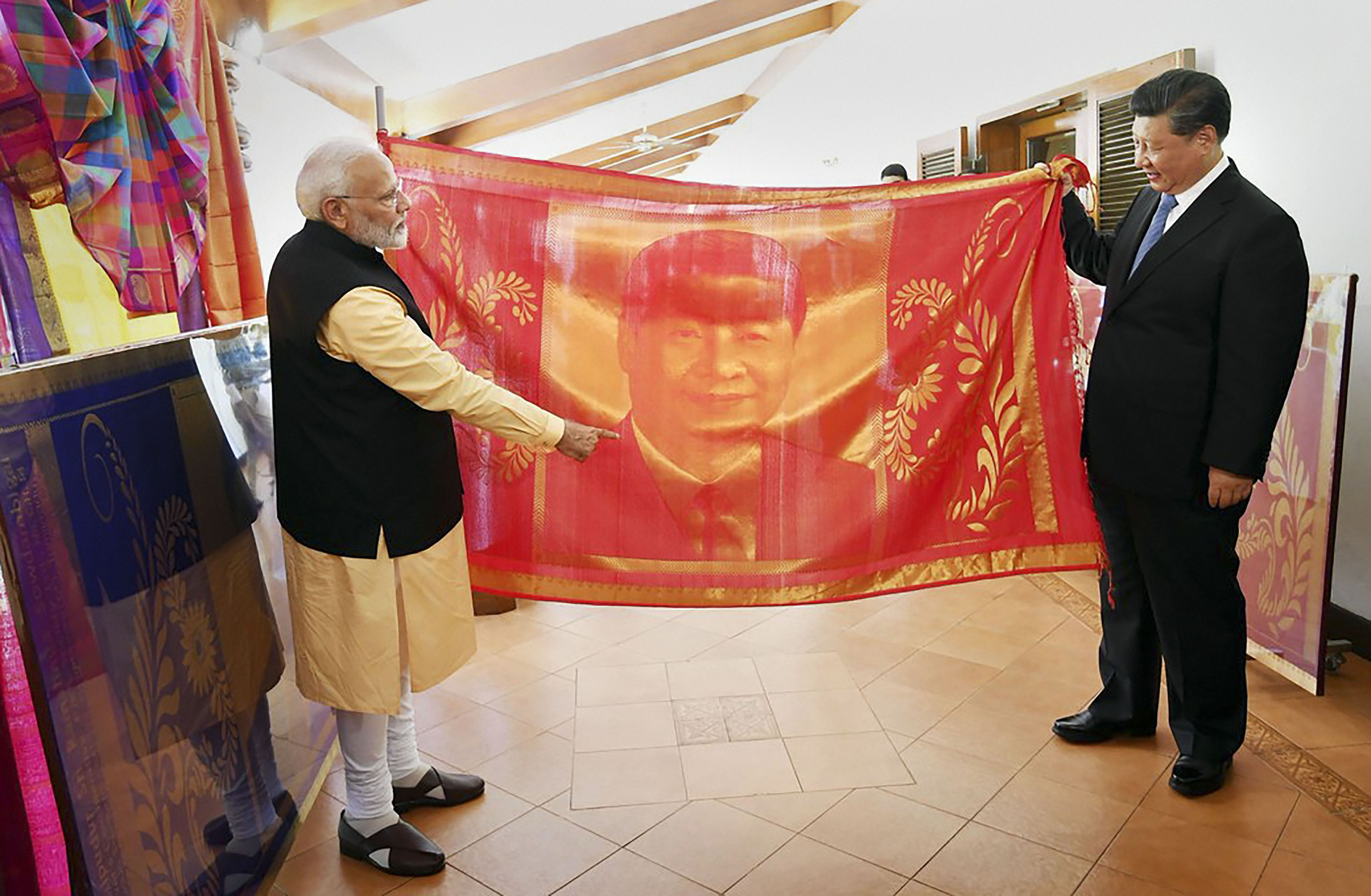 Prime Minister Narendra Modi gifts a hand-woven silk portrait of President Xi Jinping to him at Mamallapuram on October 12.