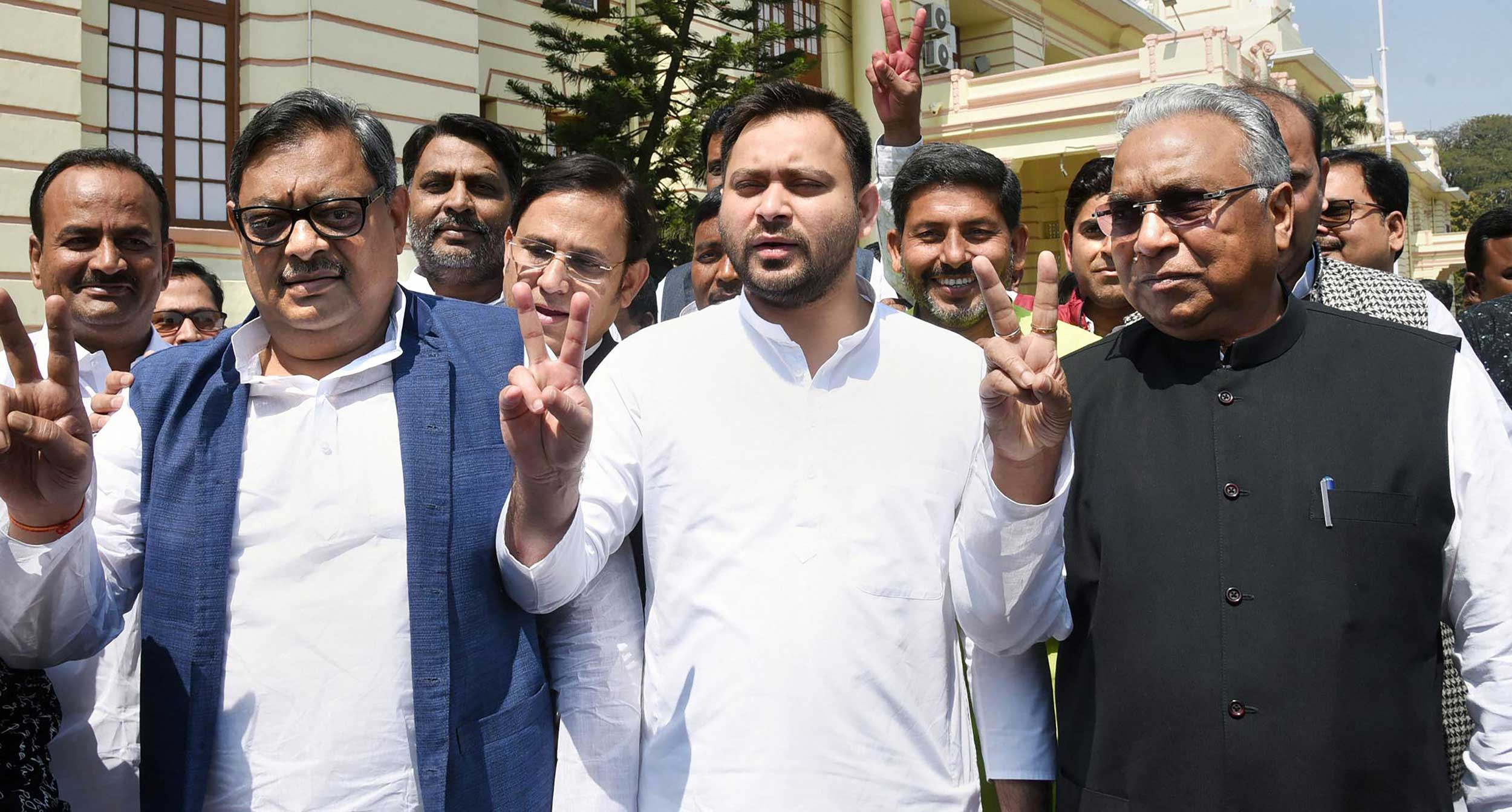 RJD candidates Prem Chand Gupta (right) and Amarendra Dhari Singh (left) with party leader Tejashwi Prasad Yadav flash victory sign after filing their nominations for Rajya Sabha elections, at Bihar Legislative Assembly in Patna, on Thursday.