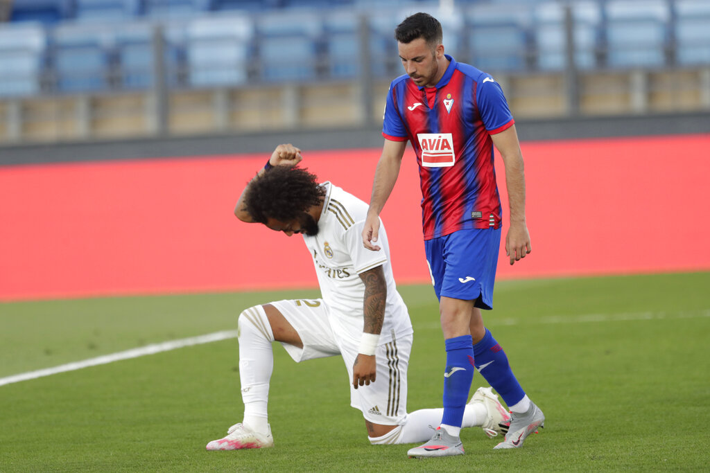 Real Madrid's Marcelo takes a knee as he celebrates his goal during the Spanish La Liga match between Real Madrid and Eibar at Alfredo di Stefano stadium in Madrid