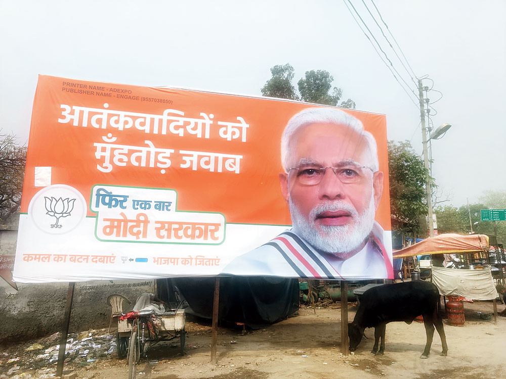 """A billboard of Modi in Baghpat town claiming """"fitting reply to terrorists"""""""