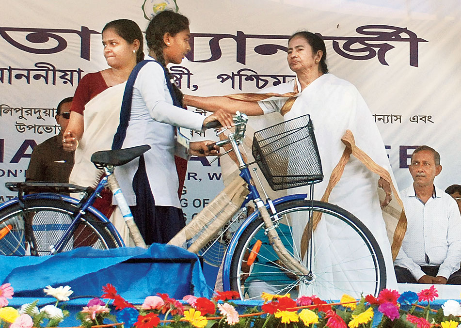 Mamata hands over a bicycle to a girl at the public meeting in Tiabon near Matialli on Thursday.