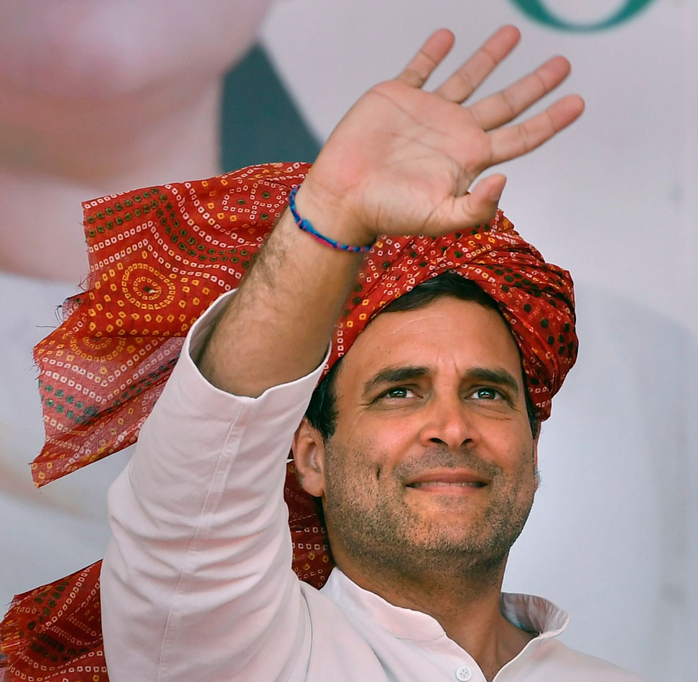 Congress president Rahul Gandhi waves at party supporters in Bhiwani on Monday