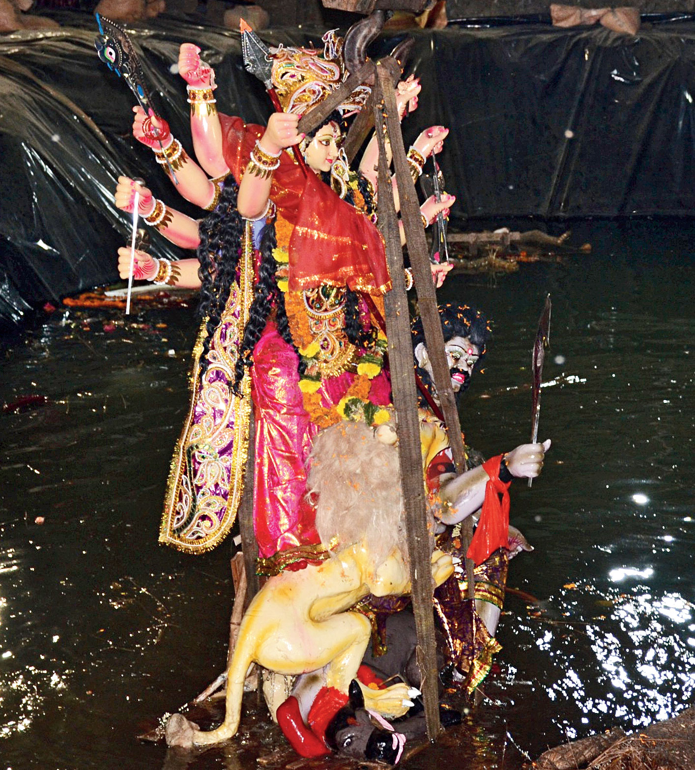 Bidding goodbye: People immerse a Durga idol in an artificial pond dug up by the Berhampur Municipal Corporation on Sunday.