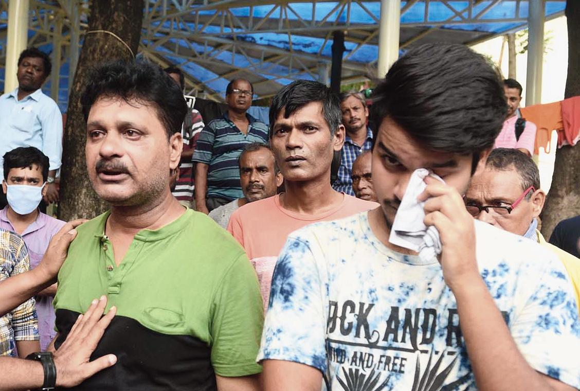 Sajal Kumar Kanjilal's cousin Rajkumar Mukherjee (left) and his son at SSKM Hospital on Sunday.