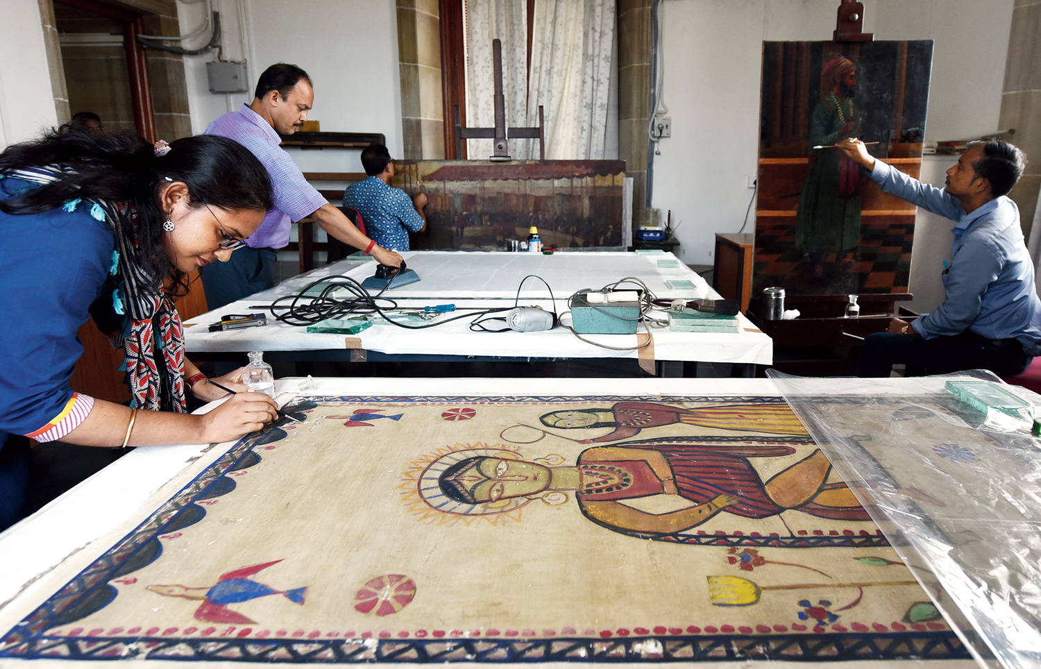 HEALING TOUCH: Restorers at Victoria Memorial Hall work on a Jamini Roy painting on cloth