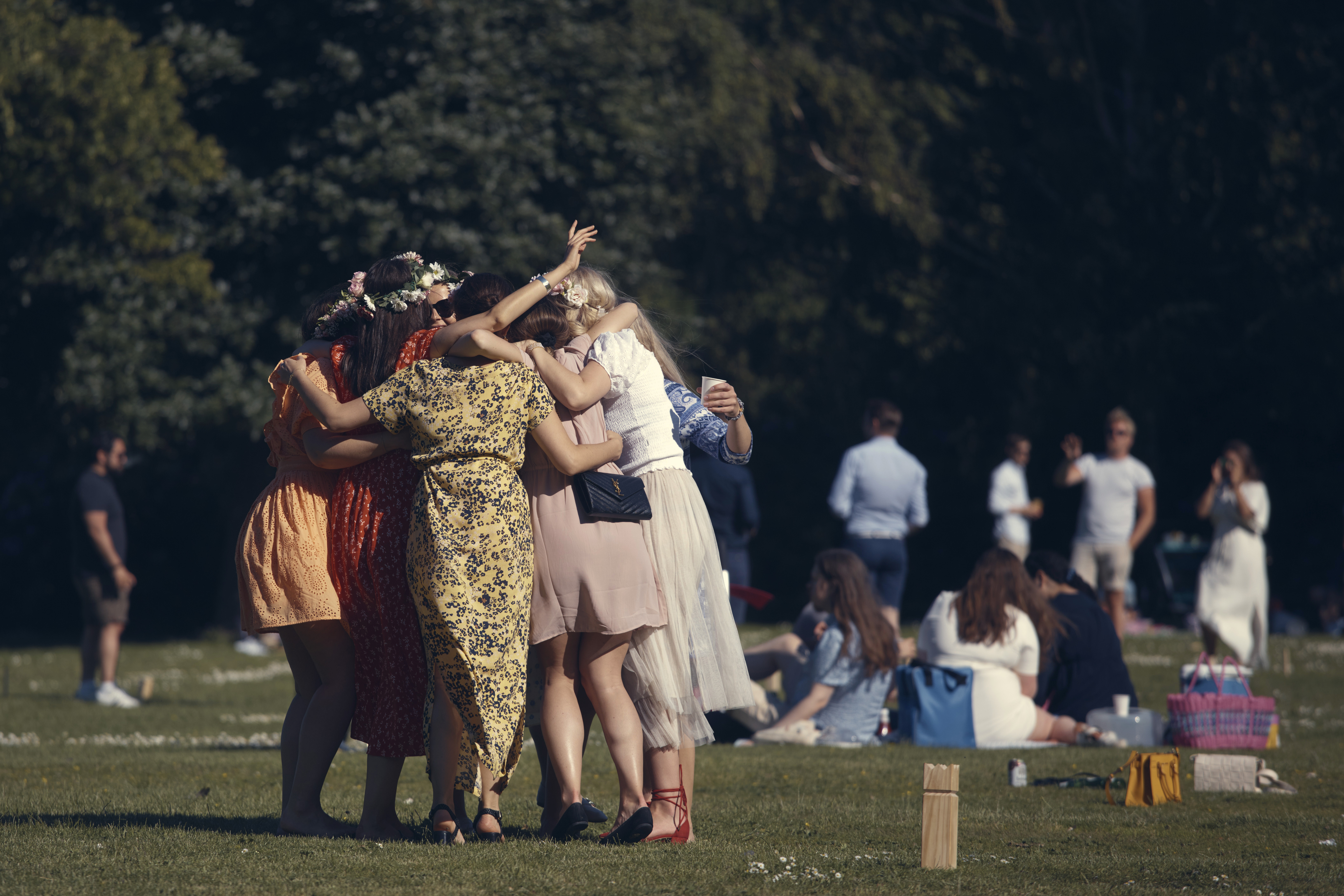 Girls celebrate as the play a game in a park during the annual Midsummer celebrations in Stockholm