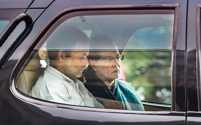 Congress President Sonia Gandhi and party leader Rahul Gandhi leave the Parliament House during the ongoing Winter Session, in New Delhi, Thursday, Nov. 28, 2019.