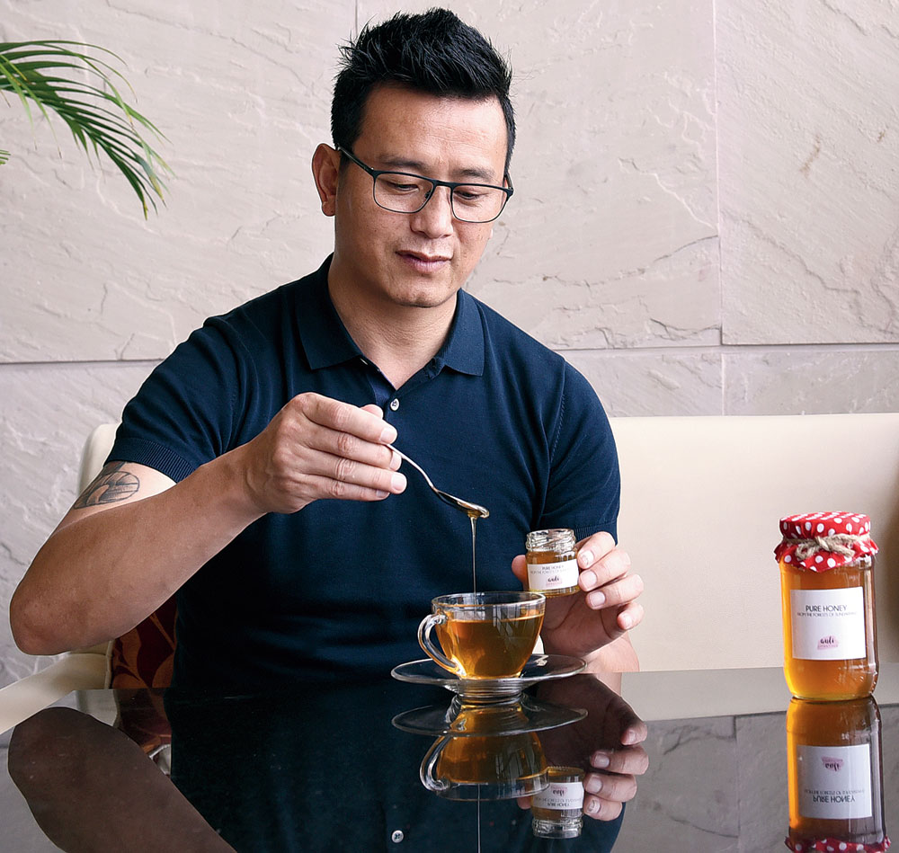 Honey is an part of Bhaichung's diet. He mixed some from the Auli stable in his cup of green tea.