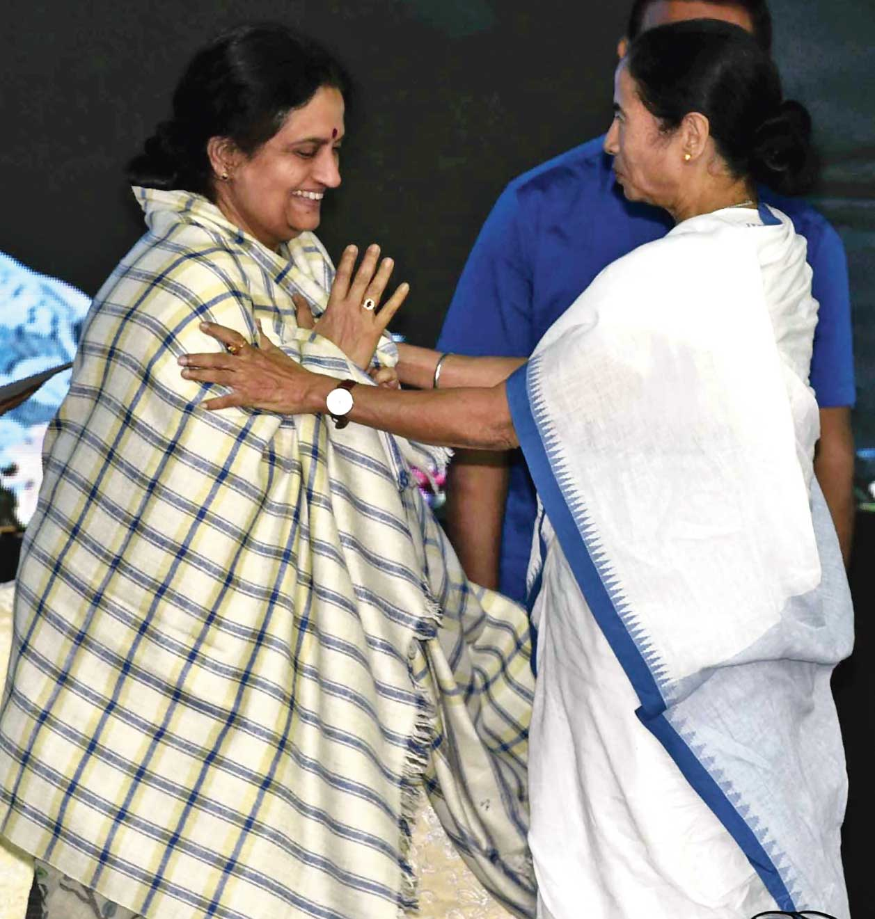 Chief minister Mamata Banerjee wraps a stole that was presented to her around Presidency University vice-chancellor Anuradha Lohia at the inauguration of the institute's campus in New Town.