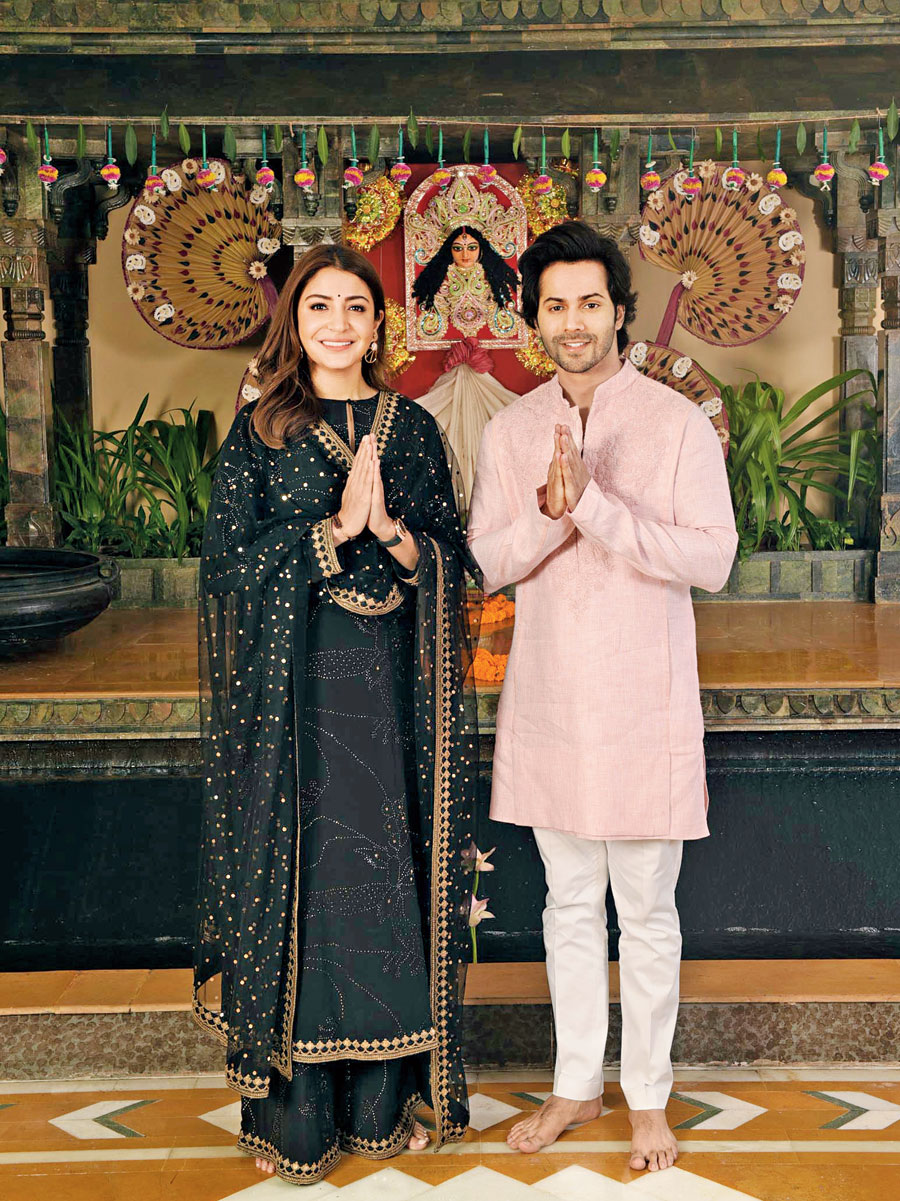 """Varun and Anushka say """"namaste"""" to t2 readers at Gharana, the venue for the t2 shoot at The Oberoi Grand, which will host the Grand Pujor Mahabhoj, available from Saptami to Dashami for lunch and dinner."""
