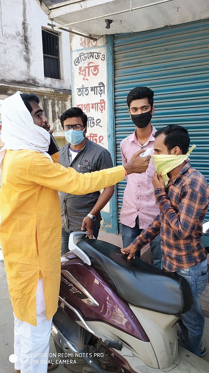 MLA Rashid reads temperature of a youth in Rampurhat on Sunday