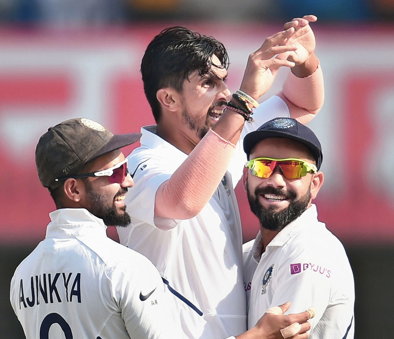 Ishant Sharma celebrates with Virat Kohli and Ajinkya Rahane the dismissal of Shadman Islam on the first day of the first Test in Indore on Thursday.