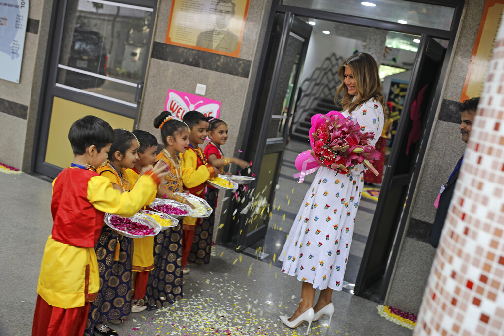 US First Lady Melania Trump is greeted by children upon her arrival at Sarvodaya Co-Educational Senior Secondary School in New Delhi