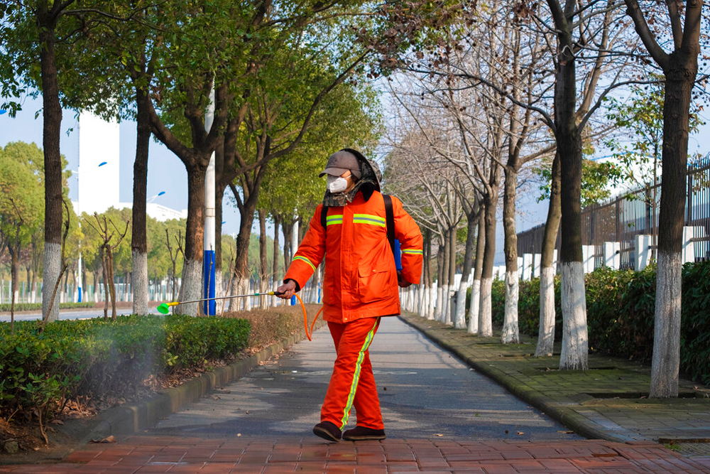 A civic official sprays disinfectant in Wuhan in central China