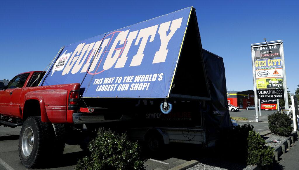A billboard advertises a gun shop in Christchurch.