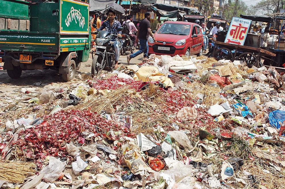 A mound of garbage lies unattended at Sabzi Mandi in Jharia, Dhanbad, on Monday.