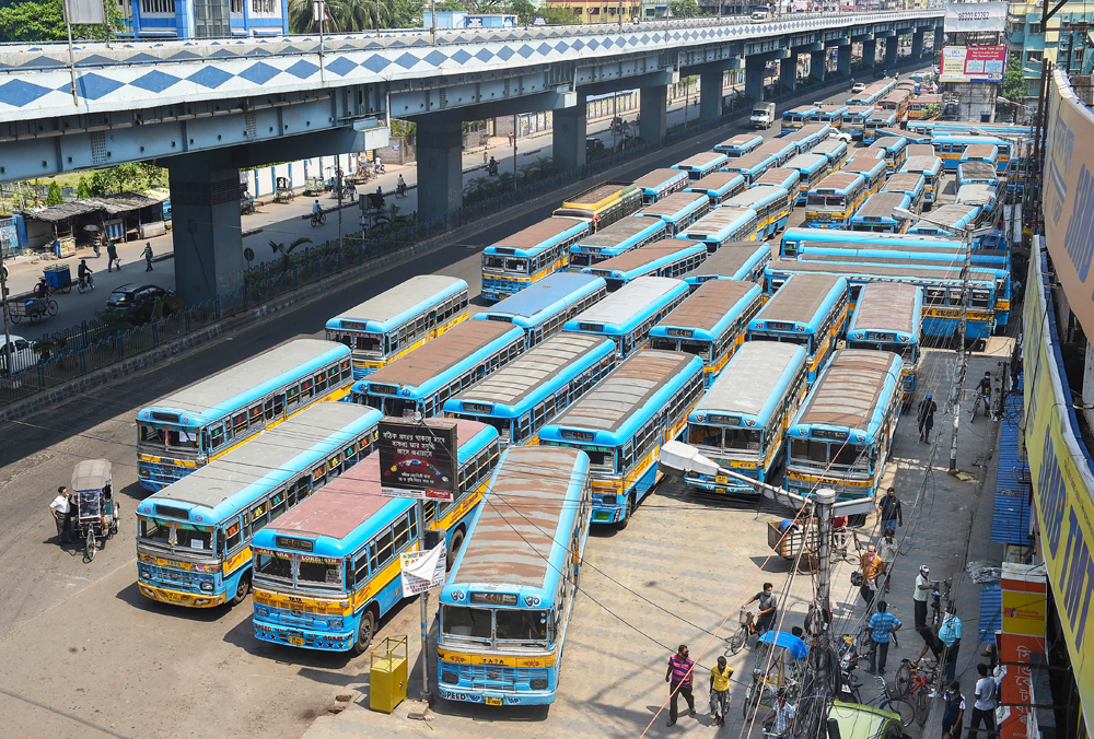Private buses seen parked at a terminus during the nationwide lockdown imposed to contain the coronavirus pandemic, in Calcutta, Wednesday, April 1, 2020.