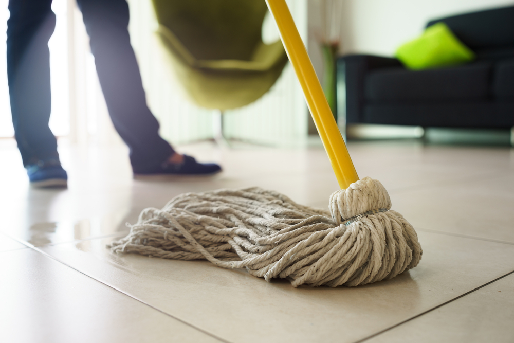 Use a mop with a vertical stick attached and keep your back and neck straight while at it. Do not stoop as the awkward position will lead to back pain.