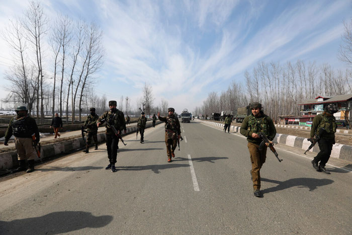 Indian police and paramilitary soldiers block a road leading towards the site of a brief gun-battle with suspected rebels on the outskirts of Srinagar, on Wednesday