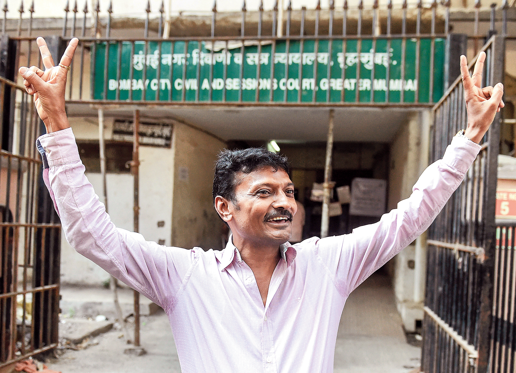 Rajendra Jeerawala, owner of the Gujarat farmhouse where Sohrabuddin Sheikh and his wife were allegedly kept in illegal detention before they were killed, celebrates outside the special CBI court in Mumbai after he was acquitted.