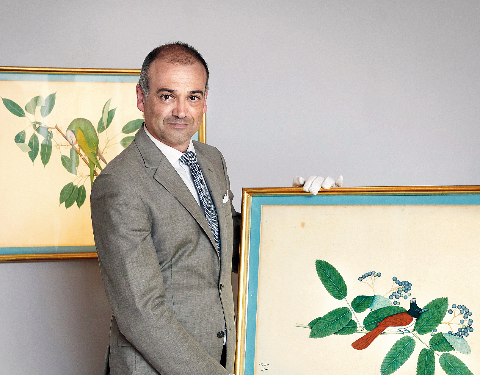 An official shows one of the two paintings during the auction in Stockholm