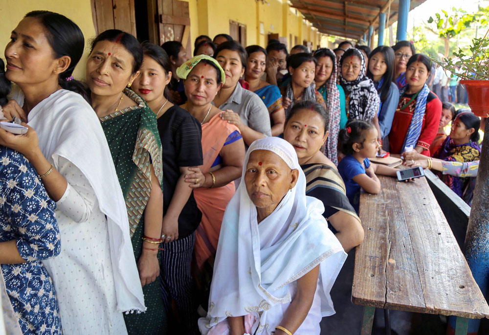 Women line up to cast their votes at a polling station during the first phase of the 2019 Lok Sabha elections, at Nawholia village in Duliajan, Assam, on April 11, 2019. In the 2014 elections, only two women MPs were elected from the Northeast, both non-tribals from Assam