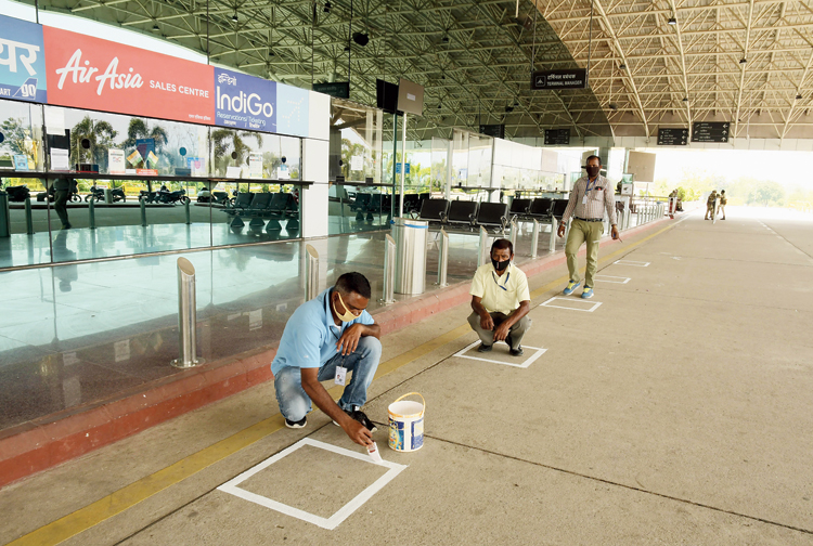 Employees of Birsa Munda Airport in Ranchi draw marks on Thursday before the airlines services resume.