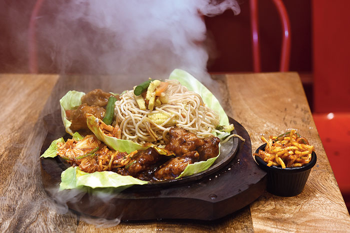The Chinese Sizzler is a wholesome meal and comes with either rice or noodles, veggies and chicken. This smoky dish has both vegetarian and non-vegetarian variants.  Rs 445 (veg), Rs 495 (non-veg)