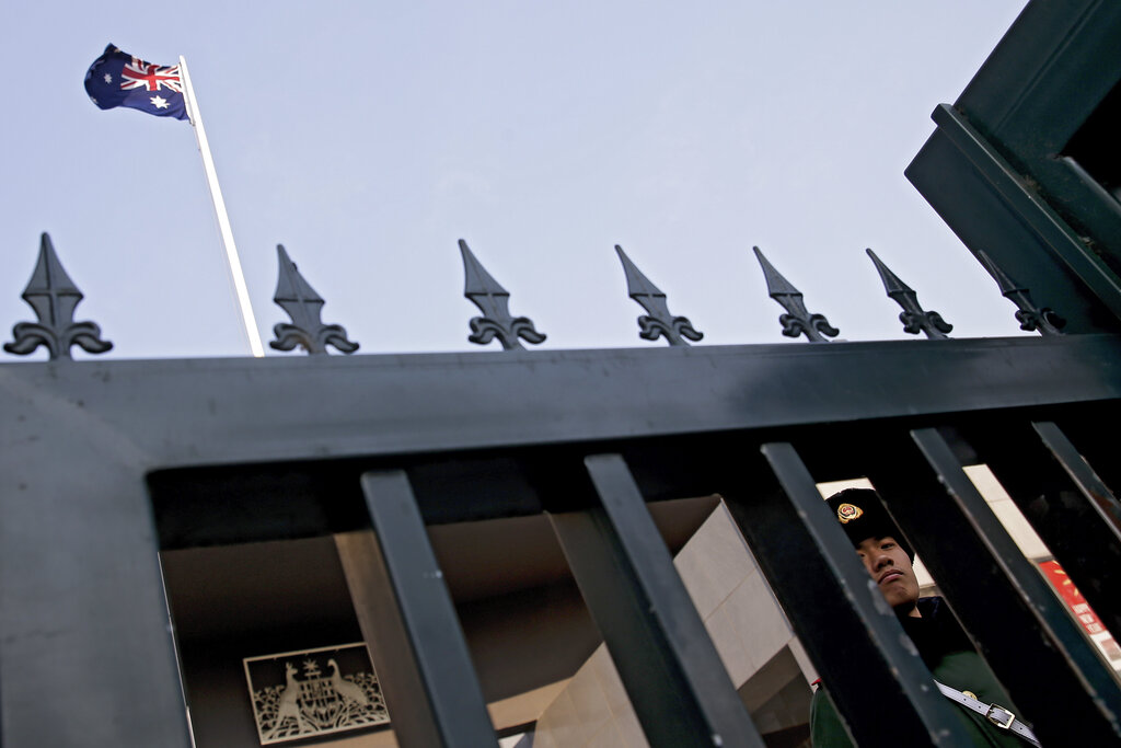 A Chinese paramilitary policeman stands guard at the Australian embassy in Beijing.