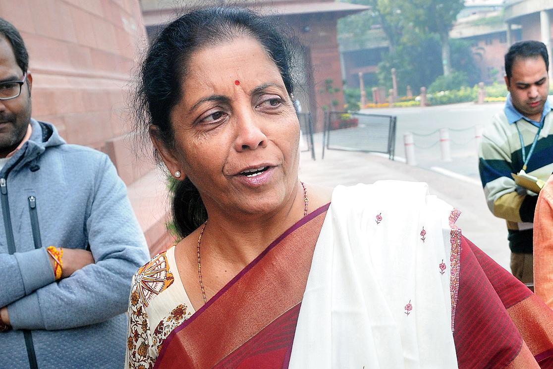 Nirmala Sitharaman outside Parliament on Friday.