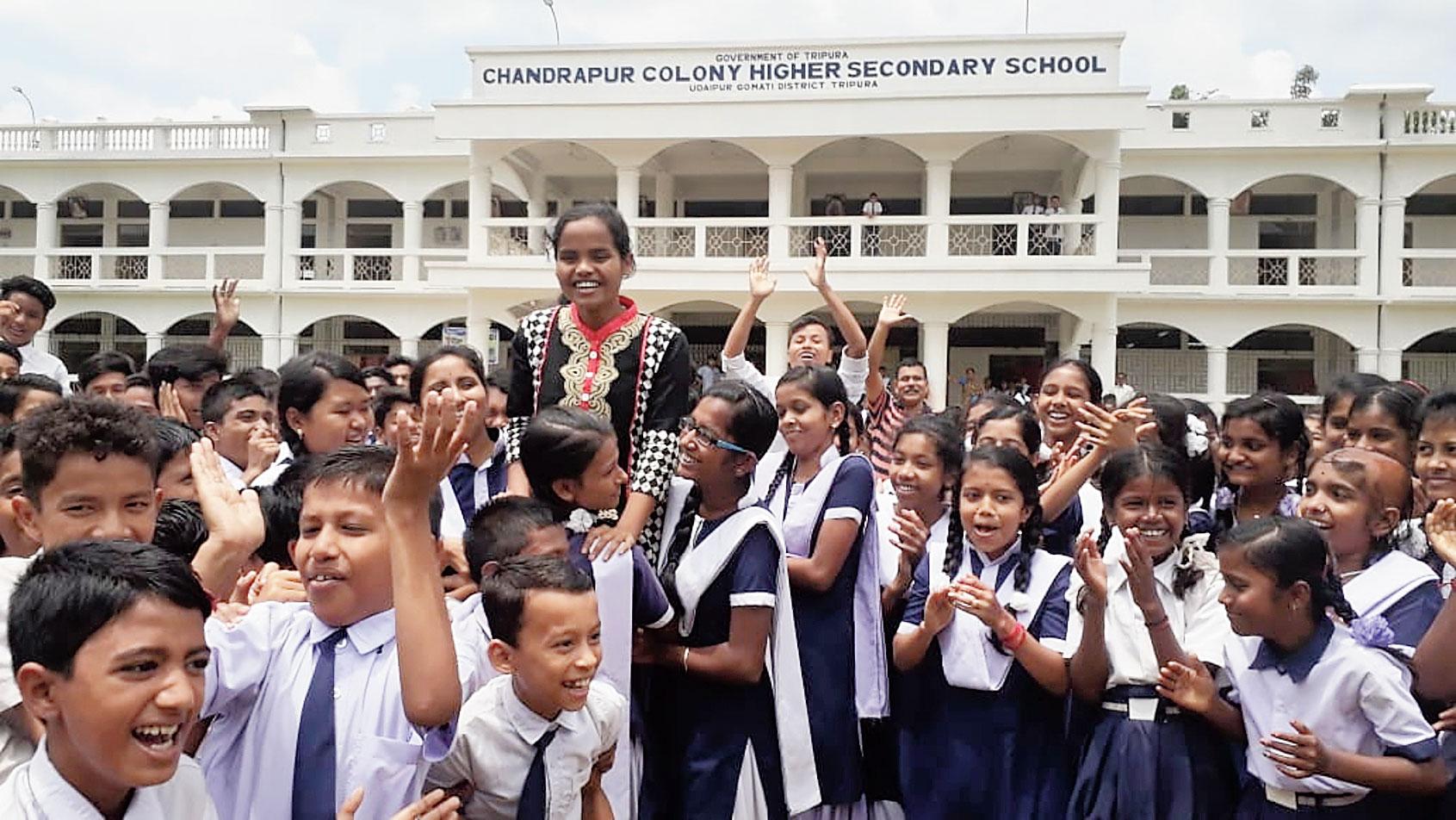 Tanushree Biswas celebrates at her school in Gomati.