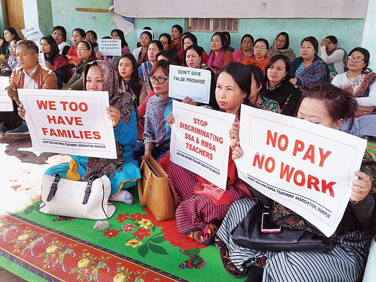 Teachers during the sit-in at Thangmeiband in Imphal on Monday