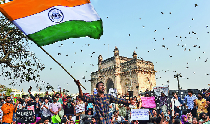 Students stage a protest in Mumbai to condemn the violence at Jawaharlal Nehru University