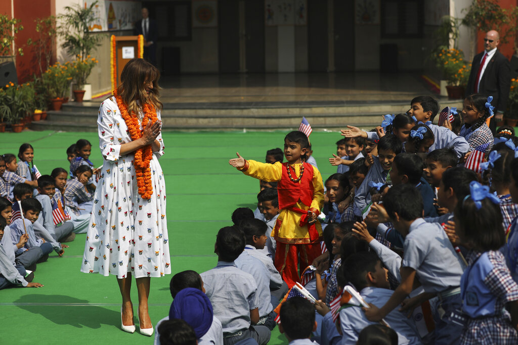 US first lady Melania Trump greets Indian style as children try to reach out to shake hands with her at Sarvodaya Co-Educational Senior Secondary School in New Delhi