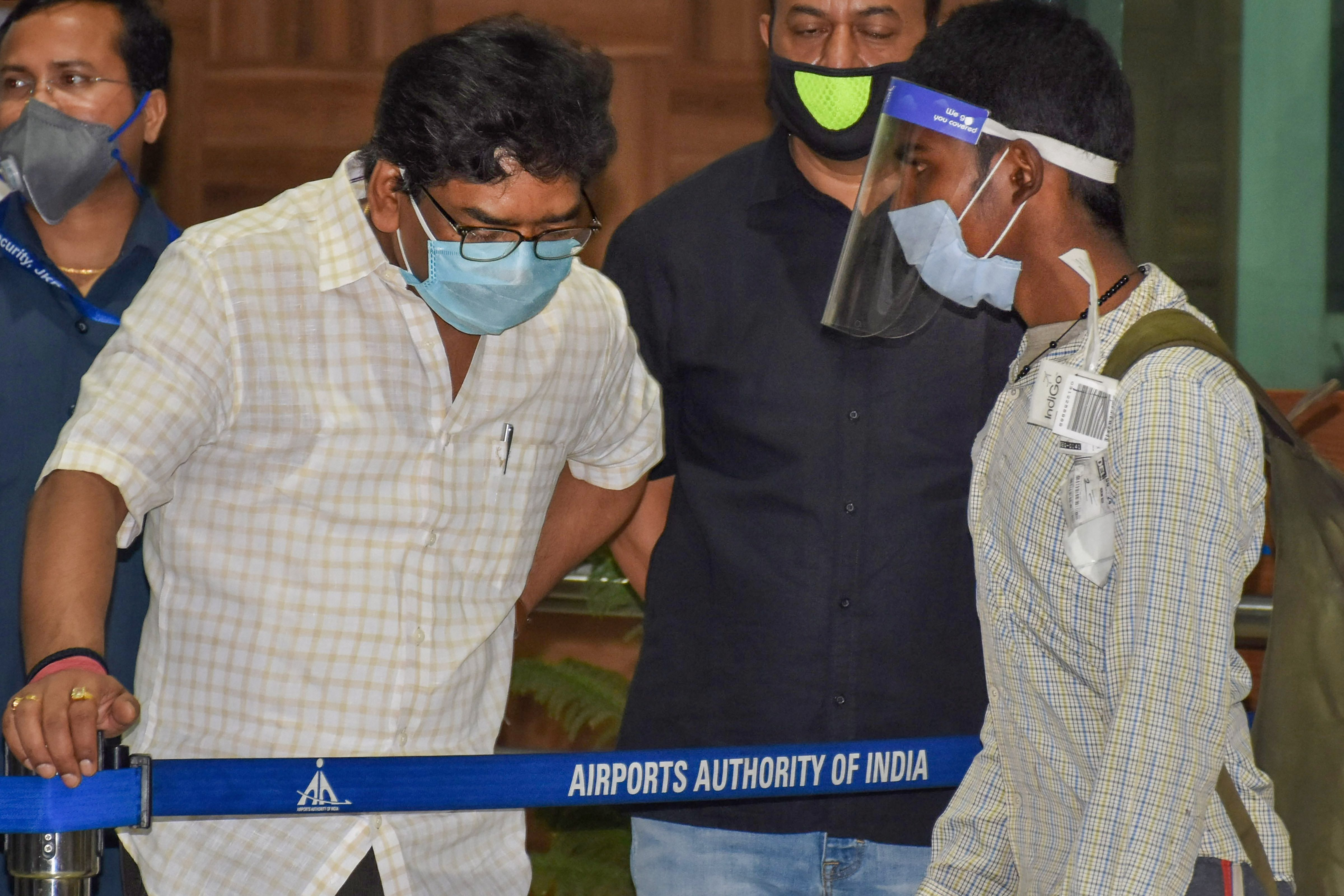 Jharkhand chief minister Hemant Soren interacts with a migrant worker as he arrives at Birsa Munda International Airport in Ranchi on Friday.