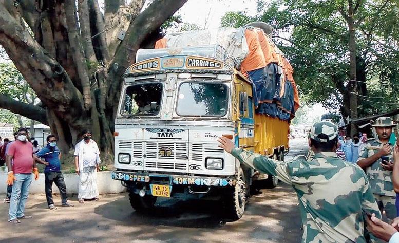 A goods-laden truck heads for Bangladesh through Mahadipur in Malda on Thursday.