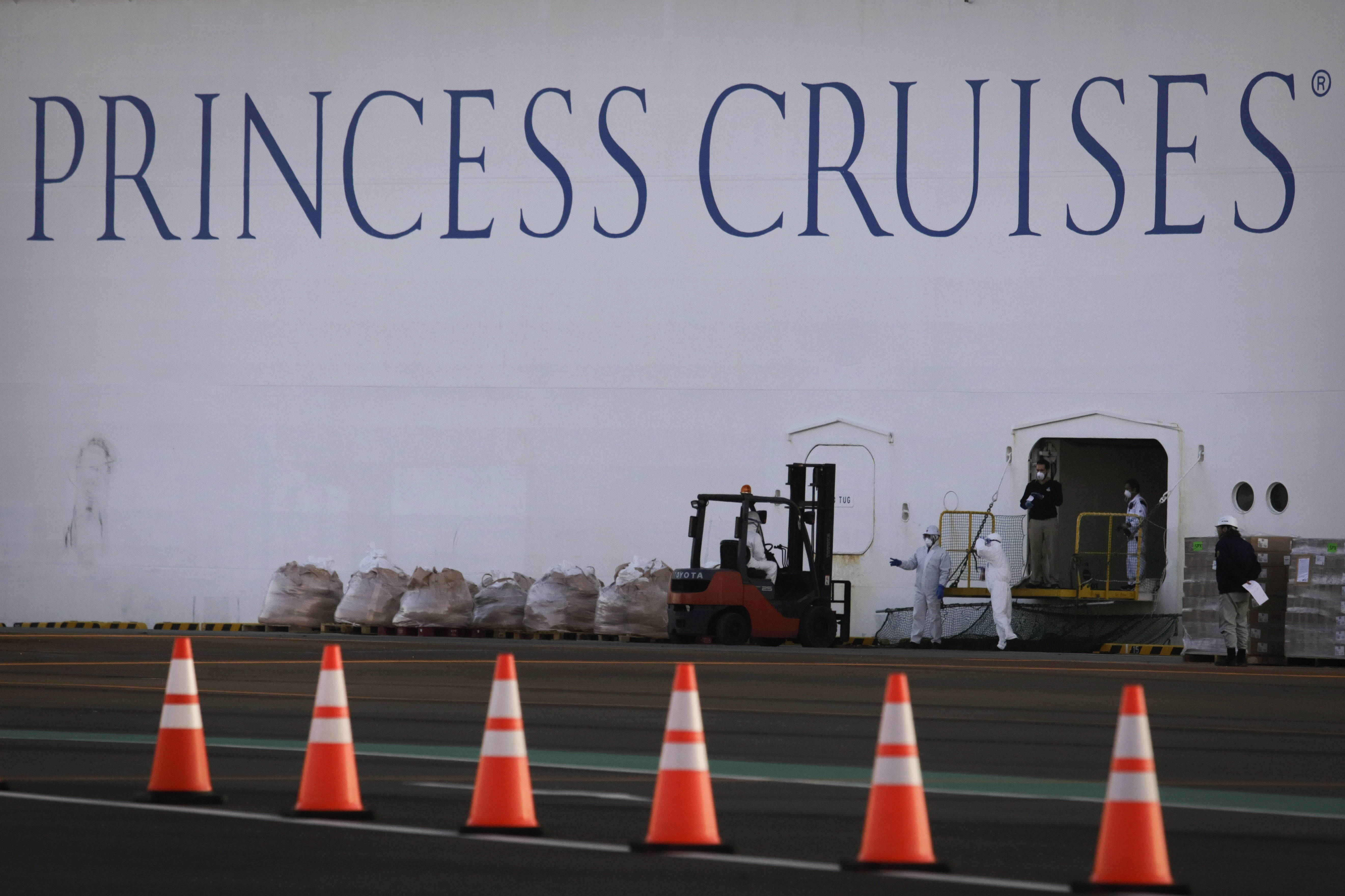 Workers load supplies onto the quarantined Diamond Princess cruise ship on Thursday, in Yokohama, near Tokyo