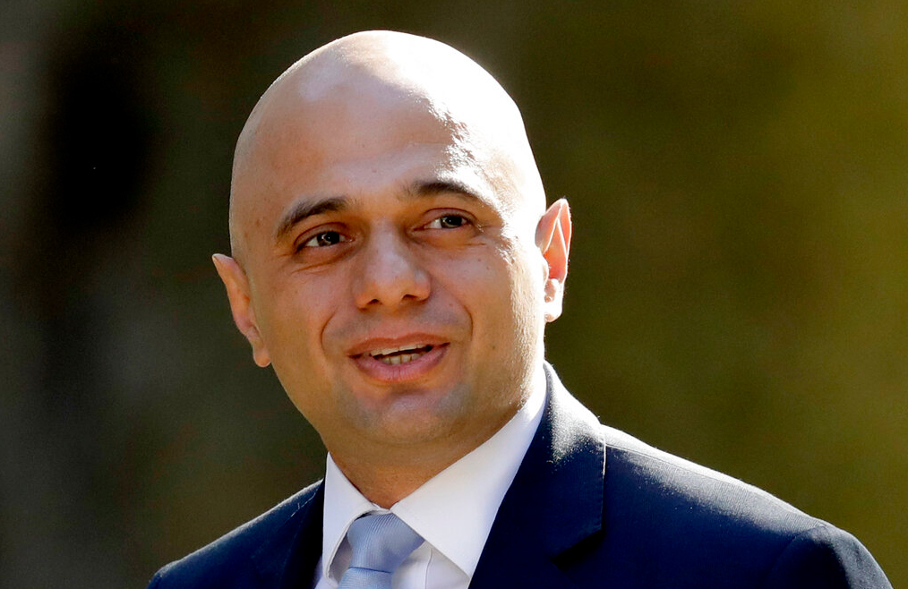 In this Tuesday, May 1 , 2018 file photo, Britain's newly appointed Home Secretary Sajid Javid arrives for a cabinet meeting at 10 Downing Street in London.