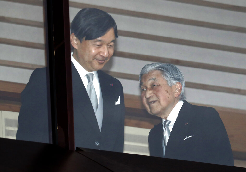 In this December 2018 photo, Japan's emperor Akihito, right, accompanied by crown prince Naruhito in the balcony of the imperial palace to mark the emperor's 85th birthday in Tokyo.