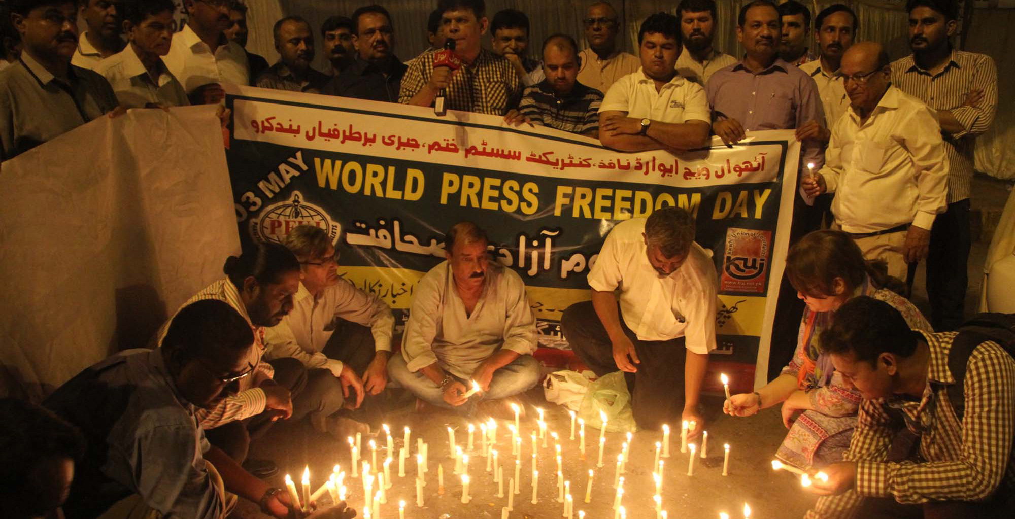 Journalists at a candle light vigil to pay tribute to slain journalists and media persons, on the occasion of Press Freedom Day on May 03, 2017 in Karachi.