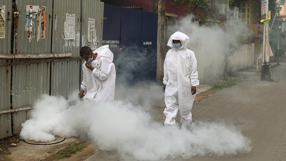 Municipal corporation workers fumigate in a locality amid concerns over Covid-19 outbreak, during ongoing nationwide lockdown, in Calcutta