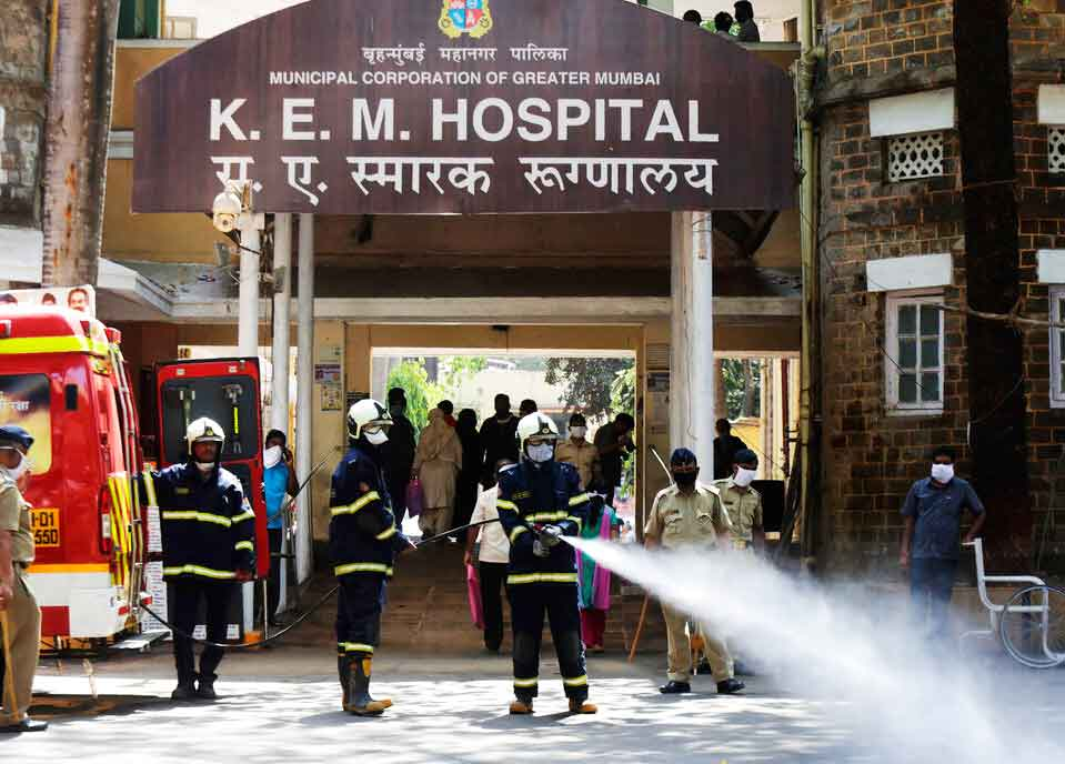 Fire brigade personnel sanitize a government hospital as part of precautionary measures against the coronavirus in Mumbai, India, Tuesday, March 24, 2020.