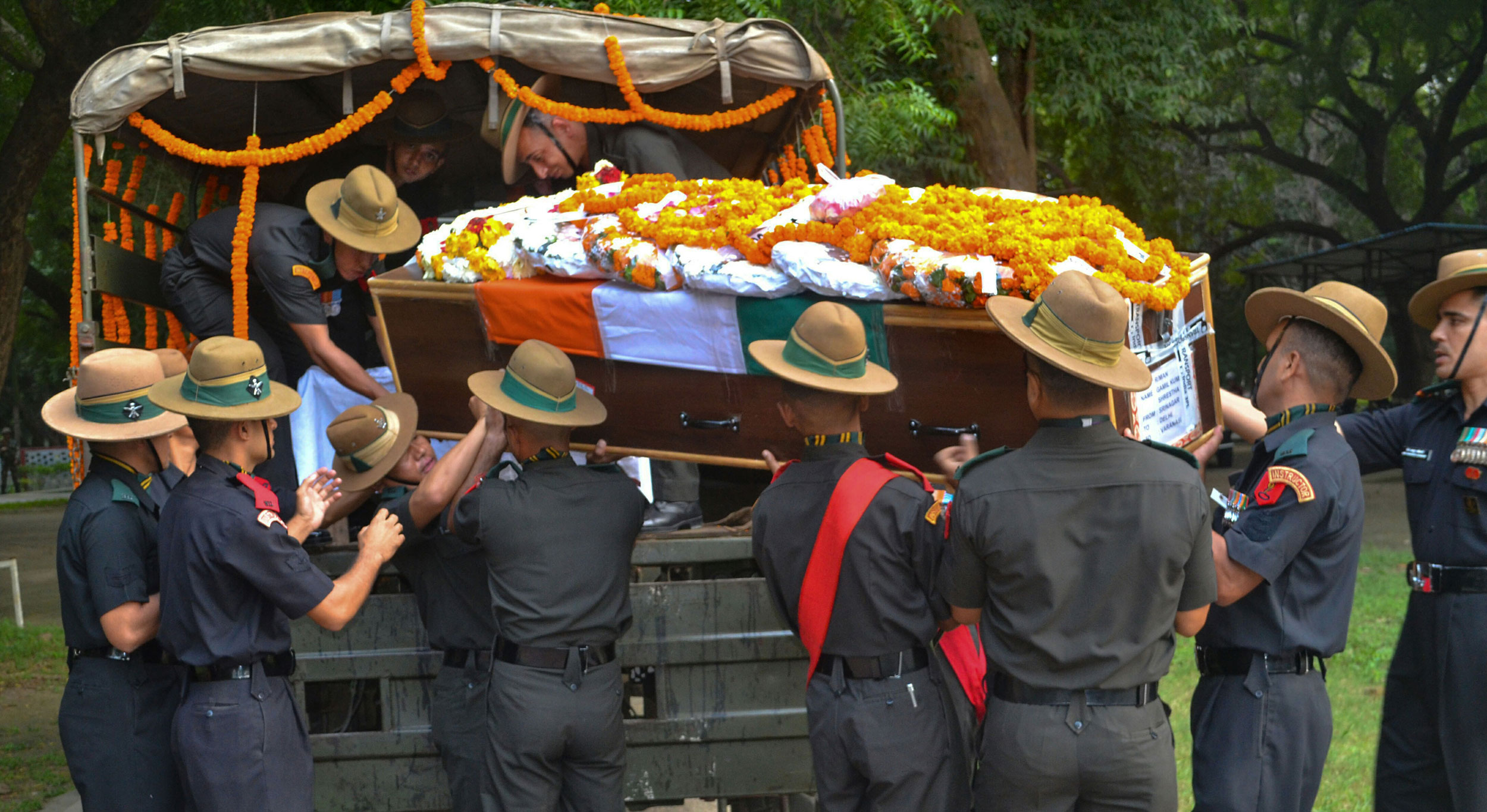 Army personnel carry the mortal remains of Rifleman Gamil Kumar Shrestha in Varanasi on October 22, 2019. The militants have been using violence to drive out non-local people, mostly those associated with the apple trade in some capacity.